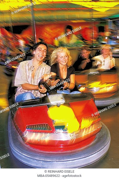 Couple on fairground in the bumper car