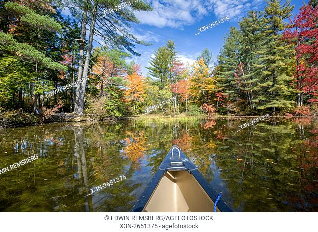 Perspective view of a canoe on Bryant Pond during the autumn in Maine