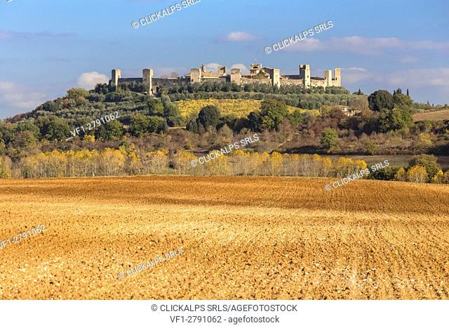 View of the medieval town of Monteriggioni from the surrounding fields, Tuscany, Italy