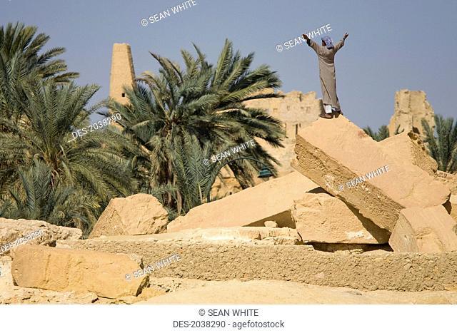 A Local Siwan Man Raises His Arms Into The Air In Siwa At The Siwa Oasis, Siwa Egypt