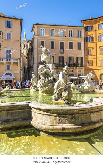 partial view of neptune fountain against the background of historic facades at piazza navona, rome, lazio, italy