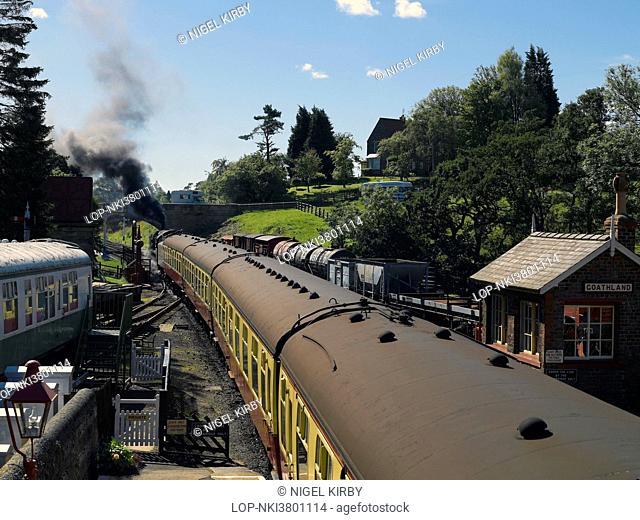 England, North Yorkshire, Goathland. A steam train leaving Goathland railway station on the North Yorkshire Moors Railway