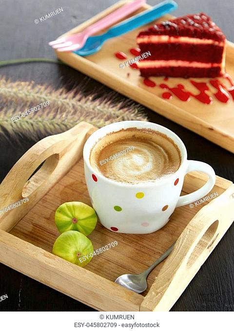 Red velvet cake with Coffee Mug and Green Fig on wood board