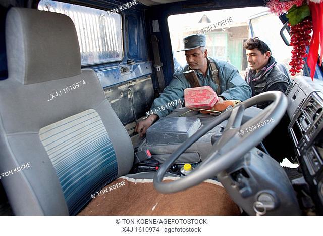 car-searching by Afghan Police in Kunduz