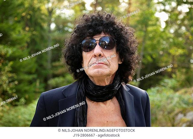 Portrait of 60 year old with sunglasses, Swedish archipelago