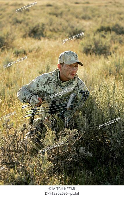 Bowhunter Hunting Antelope On Prairie