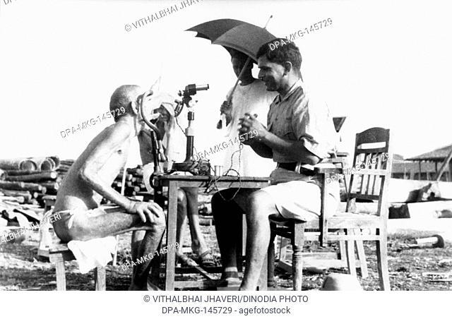 Leper patient Sanskrit scholar Parchure Shastri being examined at Sevagram Ashram , 1940 NO MR