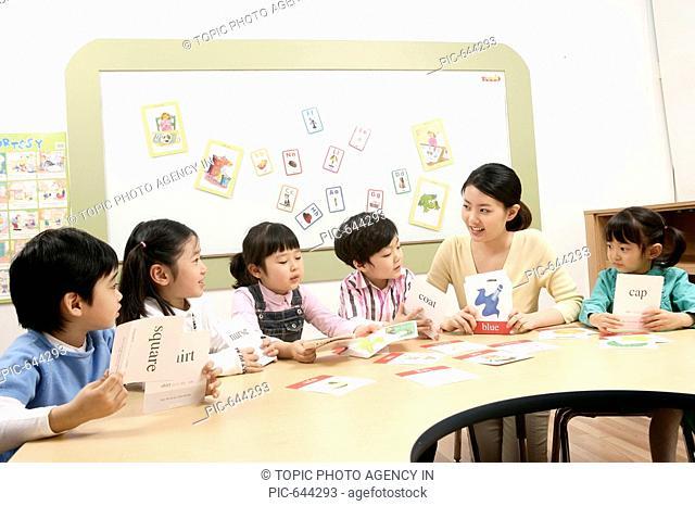 Teacher and Kids in the Kindergarten