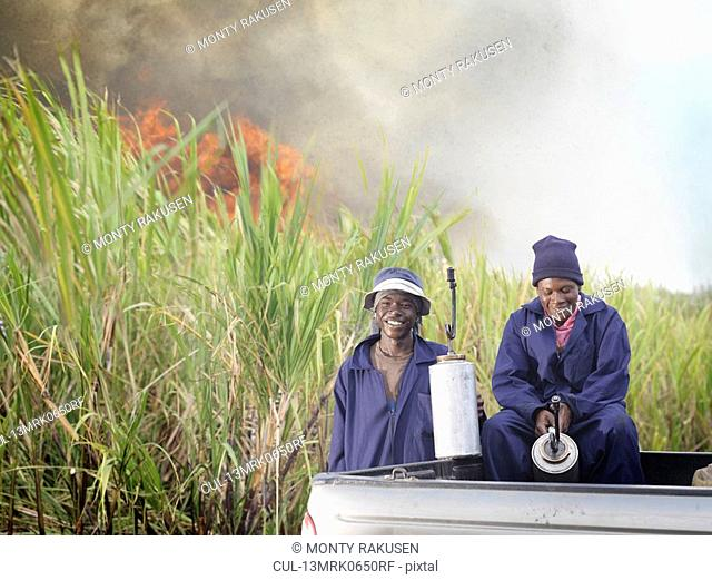 Sugar Cane Workers With Fire