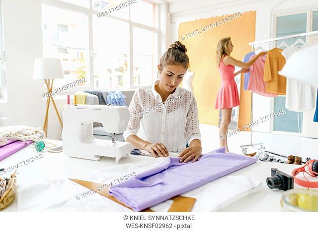 Two young women in fashion studio