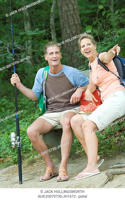 Mature couple sitting on a bench at picnic