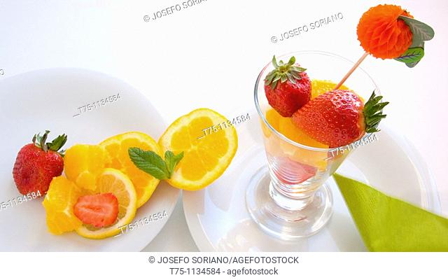 Cup with orange and strawberries