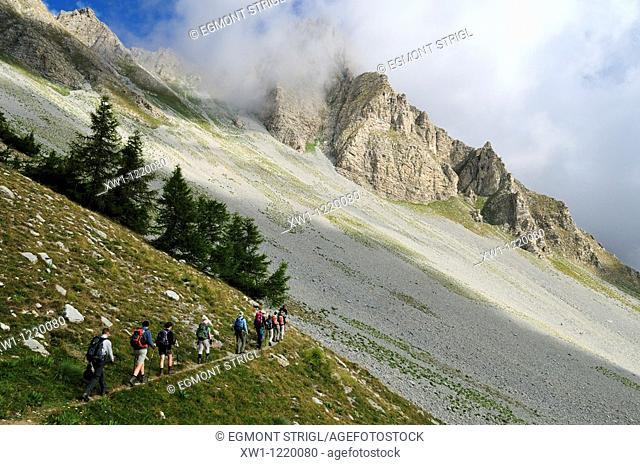 Hiking, Trekking group on a alpine trail in Mercantour National Park, Haute Verdon mountains, Alpes de Haute Provence, France, Europe