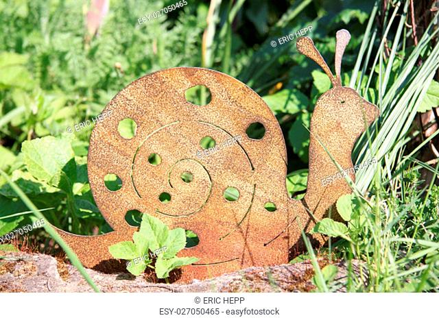 a snail from rusted metal for garden decoration
