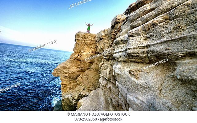 Woman in Rodalquilar cliff, El Playazo beach. Cabo de Gata Natural Park, Almería, Andalusia, Spain