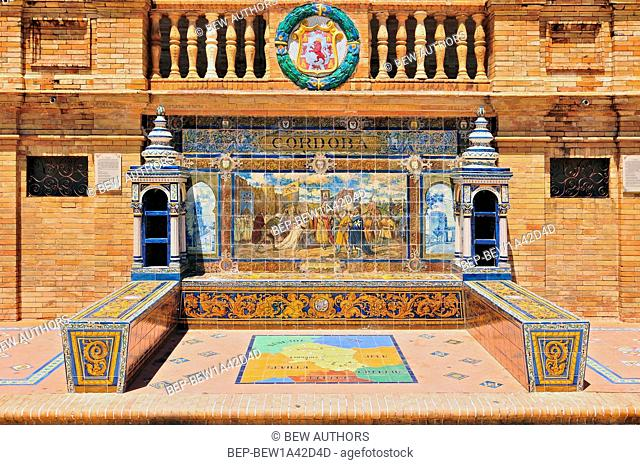 Detail of the tiled spanish provinces alcoves along the walls of the Plaza de Espana, Seville, Andalusia, Spain