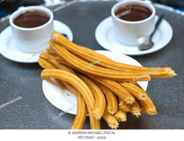 Churros with chocolate, a typical Spanish sweet snack, Madrid