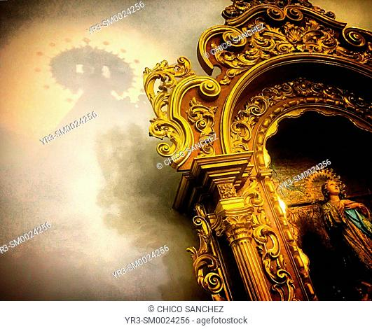 The shadow of an image of Our Lady of Carmel (Nuestra Señora del Carmen) is displayed during Easter Holy Week in Prado del Rey, Sierra de Cadiz, Andalusia