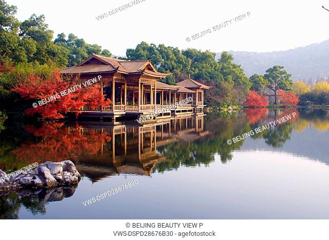 Viewing fish at Flower Pond in the West Lake,Huangzhou,Zhejiang province,China