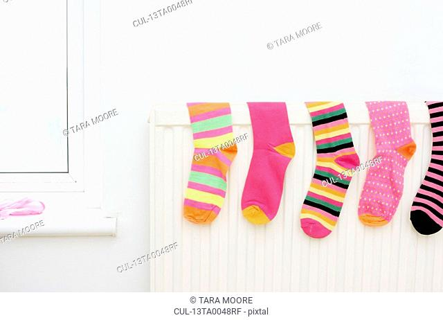 colored socks drying on radiator