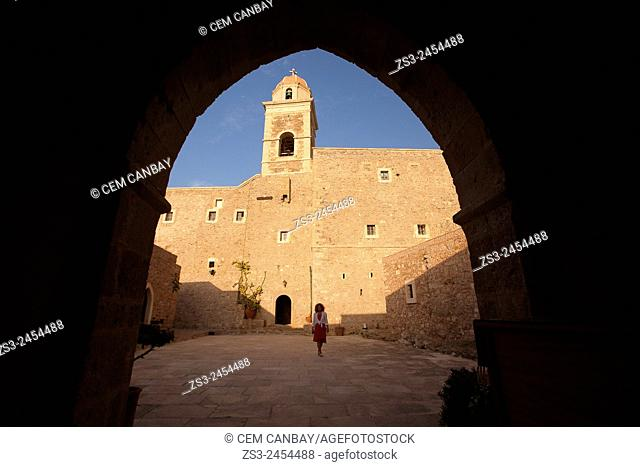 Tourist at the Moni Toplou Monastery, Akrotiri Peninsula, Crete, Greek Islands, Greece, Europe