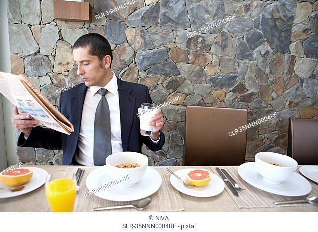 Businessman eating breakfast