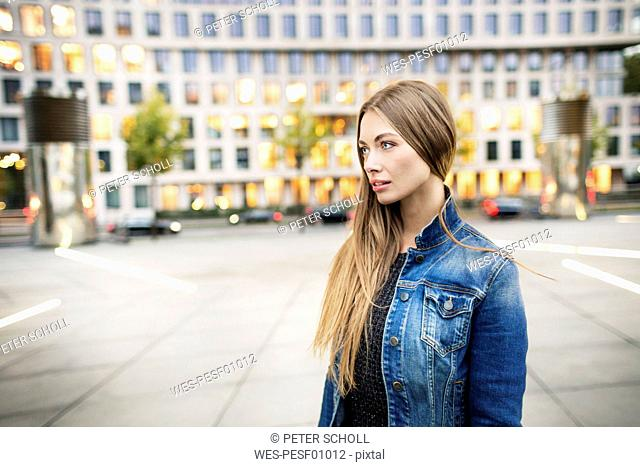 Portrait of young woman in the city