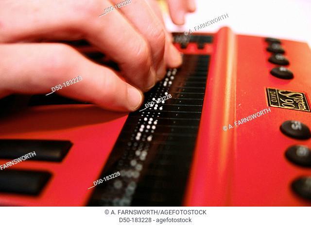 Blind man on Braille computer