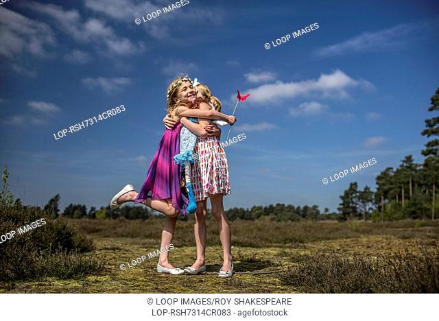 Identical twin sisters play together in the open air