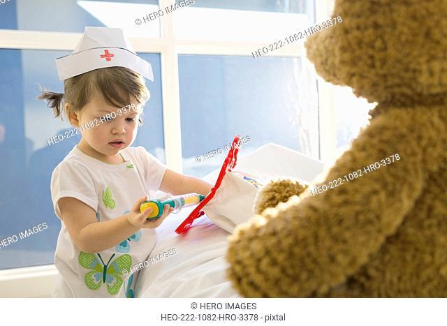 Girl in costume playing nurse