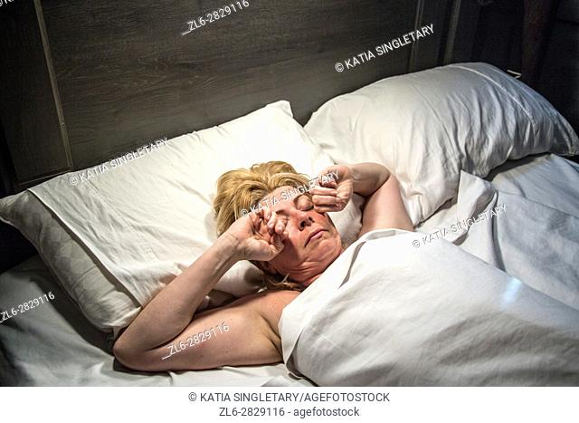 Caucasian female. slepping, streching and waking up in bed