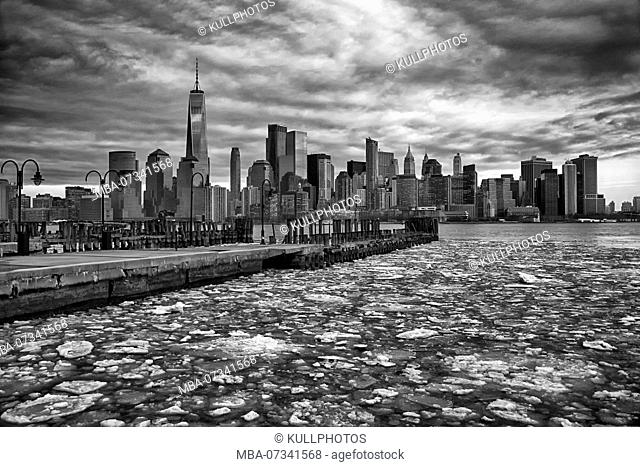 Manhattan skyline, New York City, USA, ice floes on the Hudson River, seen from Battery Park, New Jersey