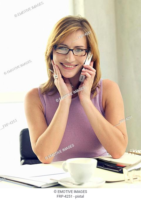 Business woman phoning