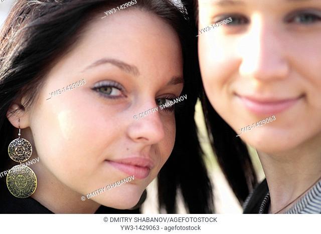 two beautiful brunette outdoor portrait