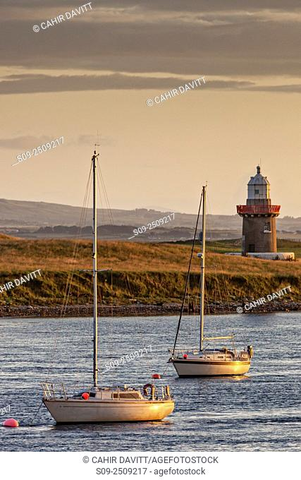 Rosses Point Lighthouse, Oyster Island and two yachts moored in the Garvogue River Estuary, Rosses Point, Co. Sligo, Ireland