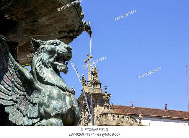 Porto University Gomes Teixeira Square Fountain detail, whit famous Carmo Church top cross in the background, Porto. Portugal