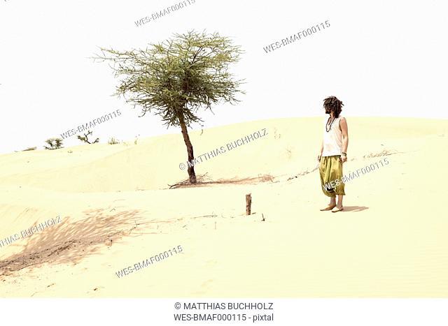 Man standing alone in the desert