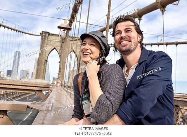 Happy couple on Brooklyn Bridge