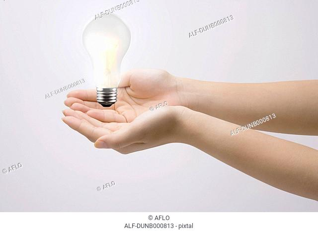 Japanese woman with light bulb