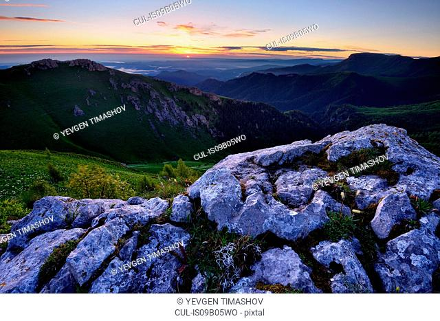 Rock formations in landscape at sunset, Bolshoy Thach (Big Thach) Nature Park, Caucasian Mountains, Republic of Adygea, Russia
