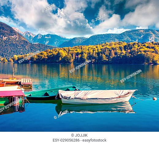 Colorful summer morning on the Bohinj Lake with boats, Triglav National Park, Julian Alps, Slovenia