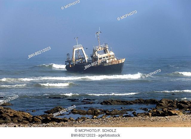 run ashore fishing boat at the beach between Walvis and Swakopmund, Namibia