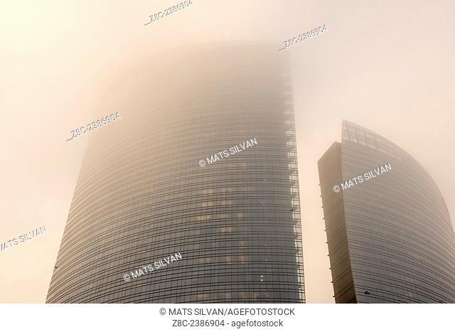 Skyscrapers in the fog in Porta Nuova in Milan, Italy