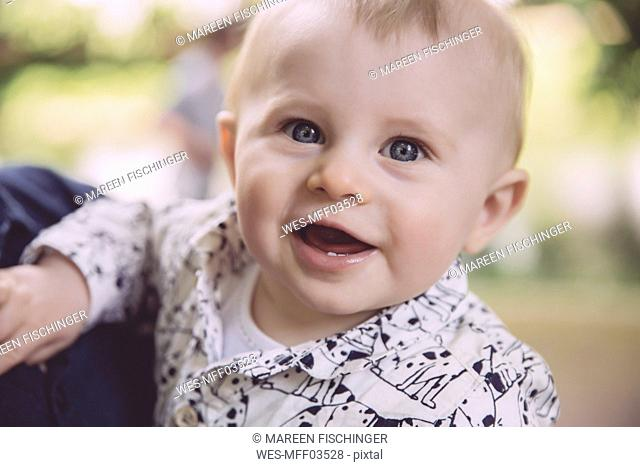 Portrait of happy baby boy outdoors