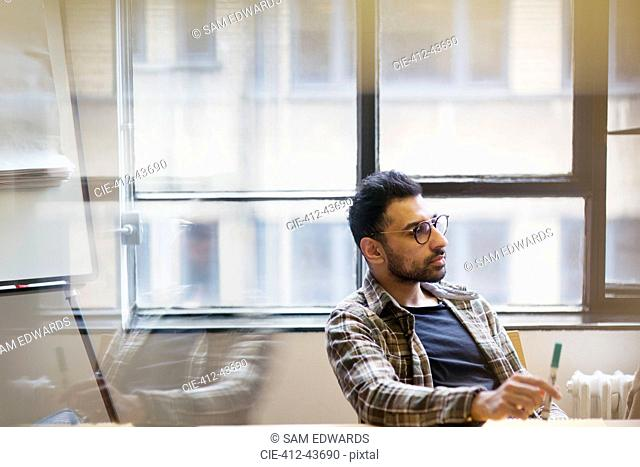 Attentive businessman listening in conference room meeting