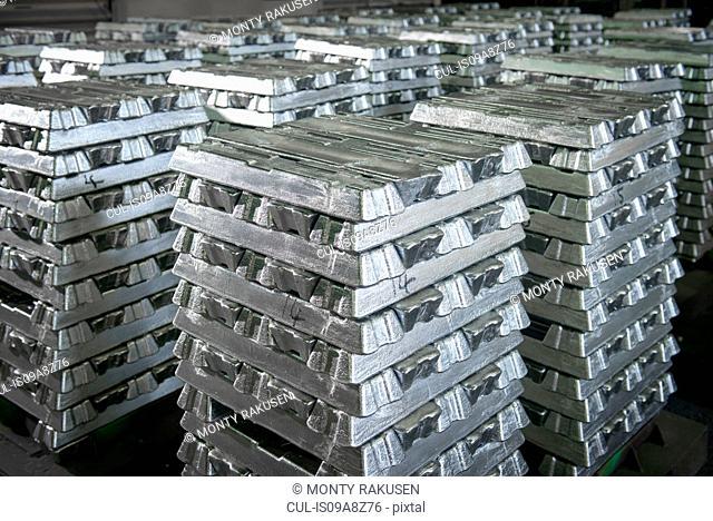 Orderly stacks of aluminum ingots