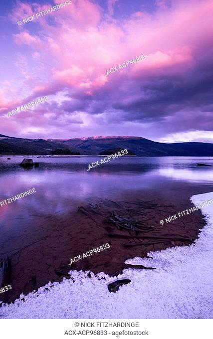 Sunset over a winter lakeside landscape, Sugar lake, British Columbia, Canada
