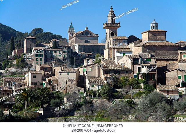View of Valldemossa, parish church of Sant Bartolomeu, Carthusian monastery at the back, Valldemossa, Comarca Serra de Tramuntana region, Majorca