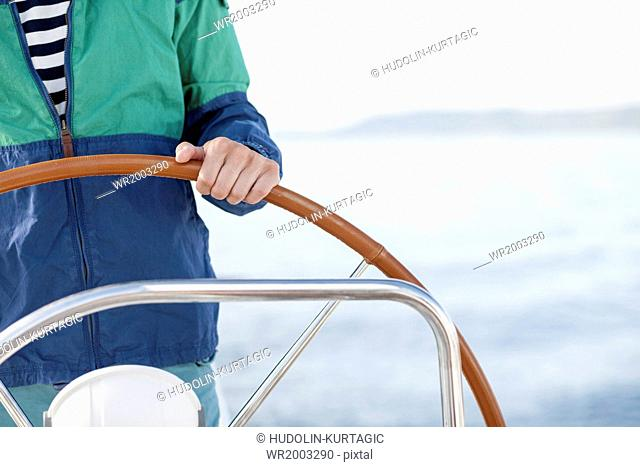 Man steering sailboat, Adriatic Sea