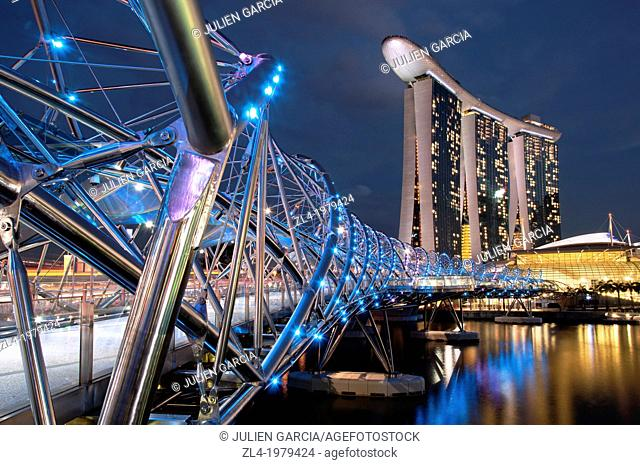 Marina Bay Sands hotel designed by the architect Moshe Safdie in the evening, viewed from the Helix bridge. Singapore, Marina Bay